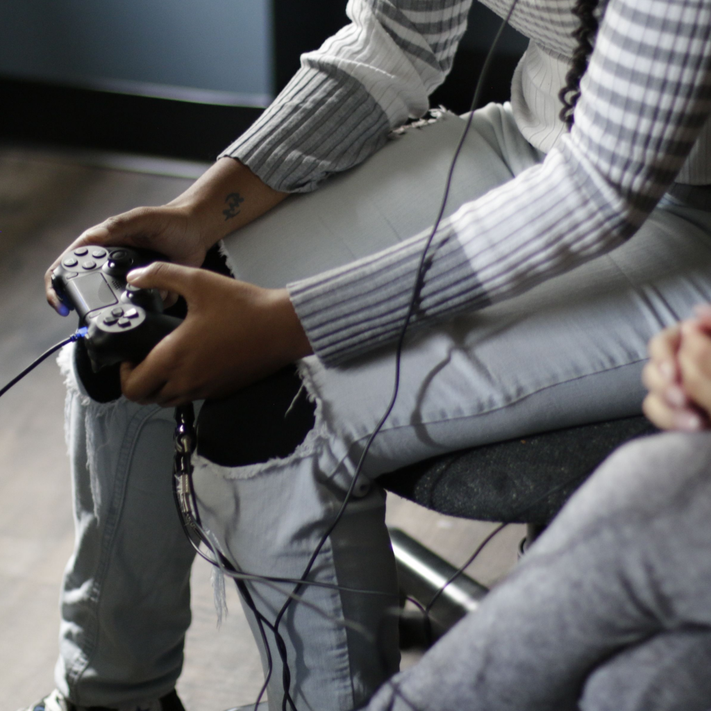 Student with Console in Greenlaw Gameroom, photo taken by Garland Rieman